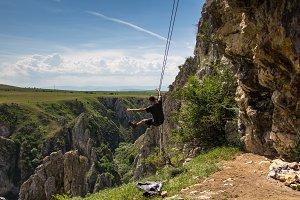 Rock climber man swinging