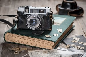 Vintage fotos, album and camera.