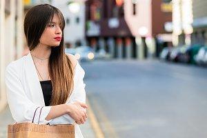 Beautiful young woman waiting