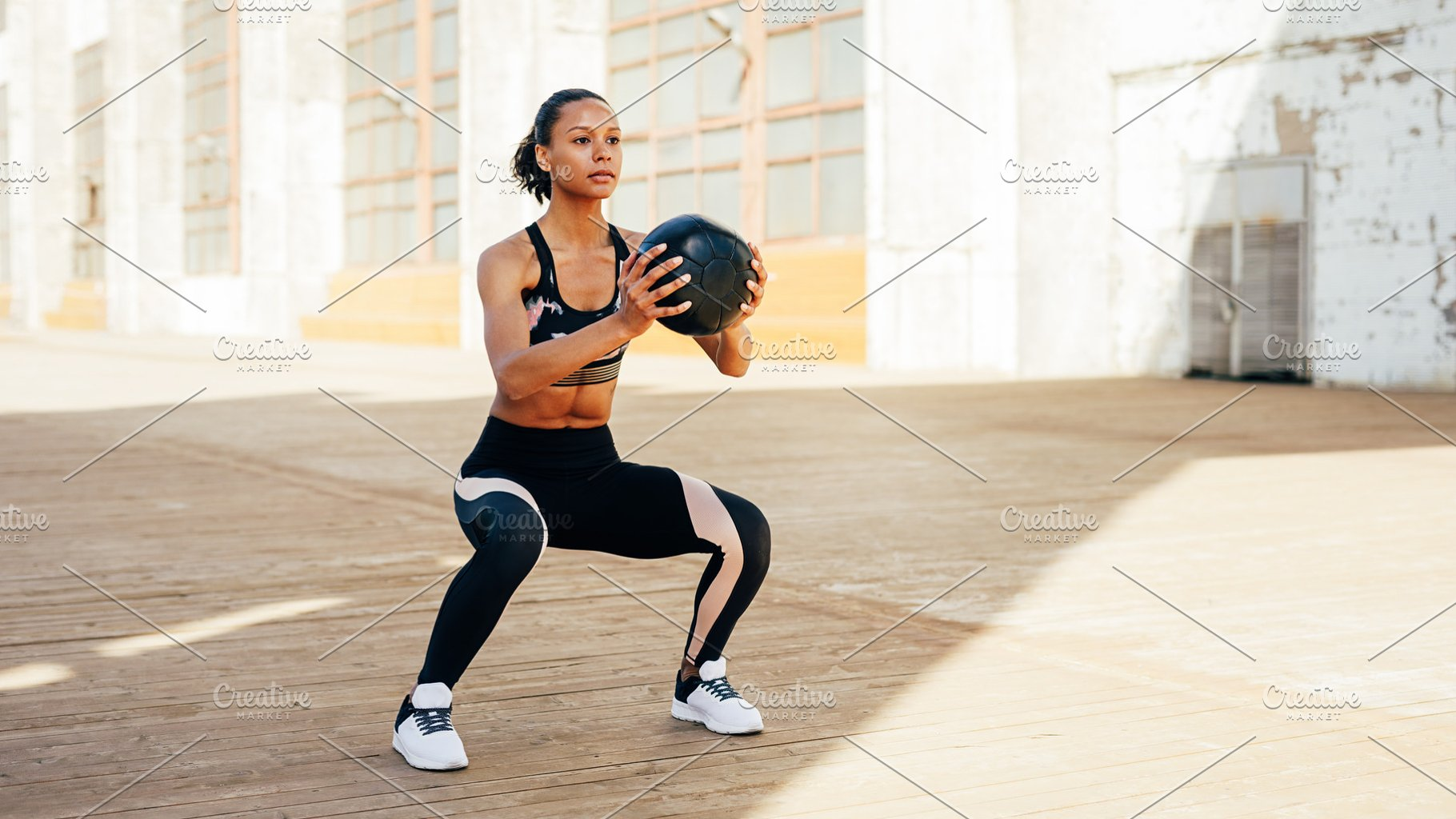 Fit woman working with medicine ball