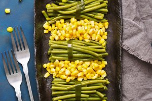 Green peas, corn and green string beans. Vegetarian food. The view from above, flat lay.