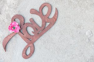 Wooden handwritten sign love concrete background