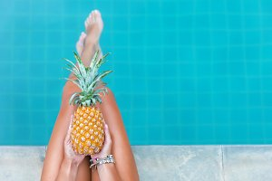 woman hold pineapple fruit pool tropical exotic