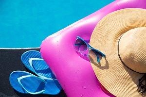 slippers sunglasses straw hat pink air mattress