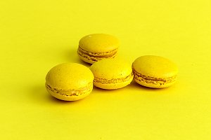 Macarons on yellow background