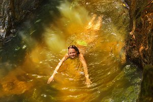 woman swimming in a natural tropical