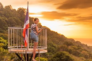 Young slim woman watch tropical exotic sunset
