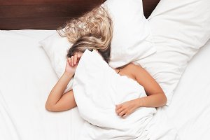 Woman in the bed don't want to wake up morning