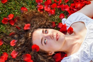 woman with rose red petals