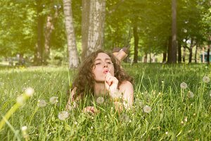 Woman having rest on meadow