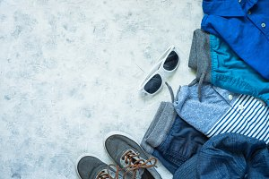 Child clothes - jeans, polo and sneakers top view.
