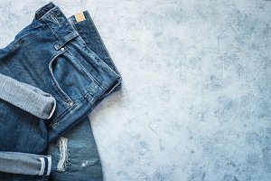 Jeans on gray stone background.