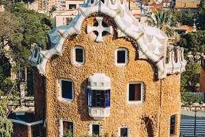 A colorful mosaic building in Park Guell in evening warm Sun light, Barcelona City, Spain