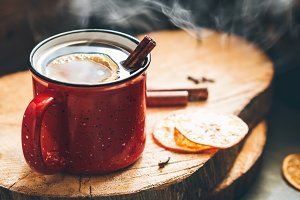 Mulled wine in a red ceramic mug