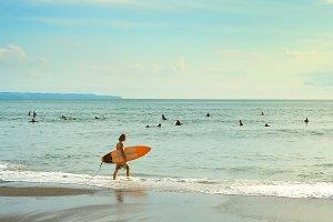 Surfer on a beach surfboard ocean