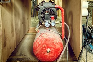 OLd red gas cylinder
