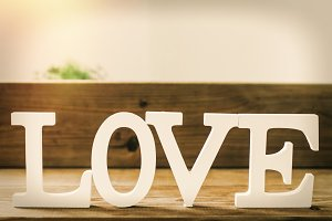 wooden letters with the word love, m