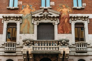 Turn of the 20th century Art Nouveau architecture and humanist wall mural at Milan's Porta Venezia district, Lombardy, Italy