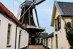 Windmill in small village, Holland