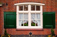 Window with shutters on brick house