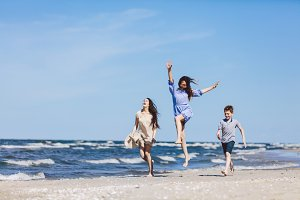 Happy family having a good time on the beach.