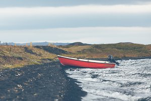 Iceland Landscape with a Red Boat