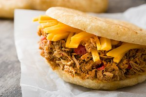 Arepa with shredded beef and cheese