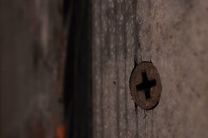Rust Screw in Weathered Painted Door
