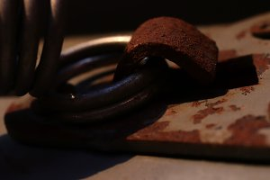 Rusty Metal Hook Holding Spring Ring