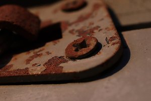 Rusty Screws on Weathered Painted Ho