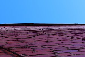 Red House Wall & Blue Sky