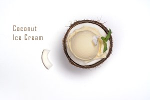 Coconut ice cream scoops in halves of coconut shell
