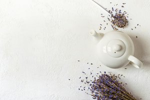 Lavender herbal tea in a white teapot