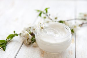 Skin cream and spring flower