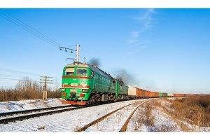 Freight train hauled by diesel locomotive. Ukrainian railways