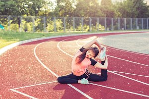 Athletic woman warming up.