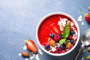 Smoothie bowl with fresh berries and nuts.