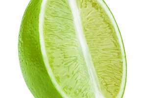 Half of lime fruit slice isolated on white