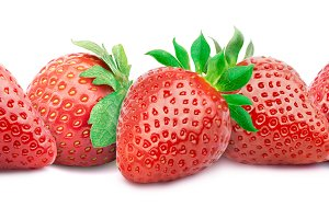 Five ripe strawberries isolated