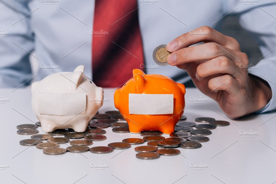 young man collecting money coins and allocate coins into categories