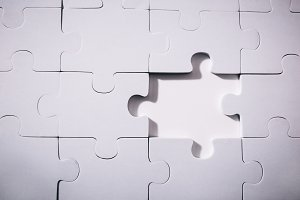Empty and blank missing piece of jigsaw in white color background - business strategy and thinking solving problem concept