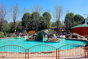 Pool with blue water and water machines as attractions in the city amusement park