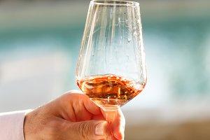 Swirling glass of rose. Wine tasting