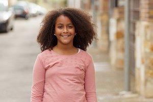 Happy afro girl outside