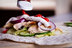 Cooking fresh homemade chicken wrap tortilla