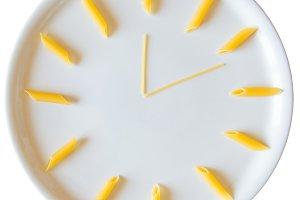 Uncooked italian pasta in clock