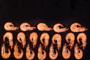 Perfect cooked prawns shrimps and text space note book top view