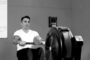 man on rowing machine - workout