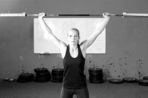 woman doing bar lifting exercises