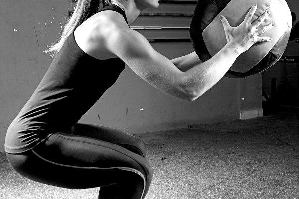 woman doing ball slams exercise
